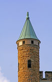 Church Tower. Stone, church tower with copper roof Stock Photo