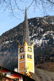 Church tower in Alpine village Bad Hofgastein , Austria. Royalty Free Stock Image