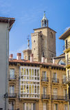 Church tower and apartment buildings in the center of Pamplona Royalty Free Stock Images