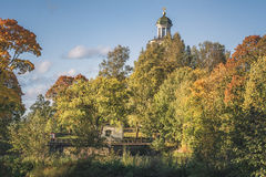 Church tower in autumn colors. Church tower showing above some very vibrant autumn  colored  trees.Located in Västanfors, Fagersta in Sweden Stock Photo