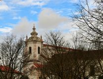 Church tower behind the trees - Maltezas Convent - Centro Ciência Viva de Estremoz. Photo of the church tower behind the trees in a winter day - Maltezas royalty free stock photo