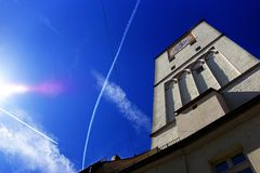 Church tower & blue skies. Church tower with beautiful blue skies and planes leaving contrails Stock Photography