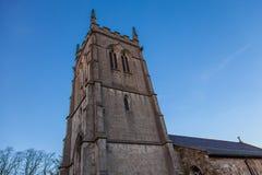 Church tower and blue sky Stock Photos