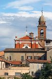 Church tower and buildings cityscape Rimini Stock Image