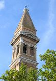 Church tower of BURANO near Venice and blue sky Stock Photos