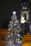 Church tower and christmas tre in prague. Night time Stock Photography