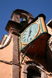 Church tower with clock. Strange church tower with clock in Bosa, Sardinia Royalty Free Stock Image