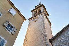 Church tower with clock on facade in Budva in Montenegro royalty free stock images