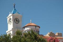 Church tower with clock. In the Greek city Pythagoreio on the island of Samos Stock Photos