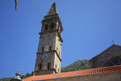 The church tower with a clock in Perast Royalty Free Stock Image