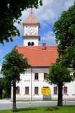 Church with tower. Church with clock tower in Slovenia Royalty Free Stock Image