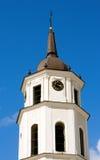 Church tower clock in Vilnus Royalty Free Stock Image