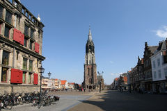 Church tower of Delft. Tower of the New Church and market square of Delft stock photo