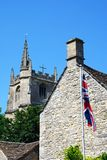 Church tower and flag, Castle Combe. Royalty Free Stock Photos