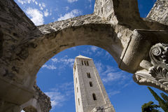 Church tower framed by stone arcs royalty free stock photos