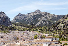 Church tower of grazalema. See the steeple and clock, is surrounded by mountains and highlands. It is located in the Spanish province of Cadiz, is a sunny day Royalty Free Stock Photos