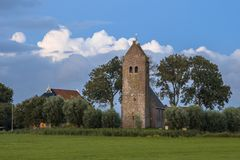 Church with tower. In hamlet of Feytebuorren on frisian countryside near Blauwhuis. Friesland, Netherlands Royalty Free Stock Photos