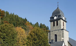 Church tower on hillside royalty free stock photos