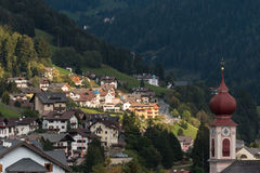 Church tower and houses in Ortisei, South Tyrol Stock Images