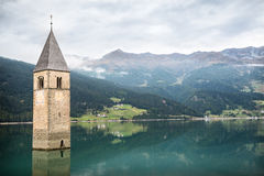 Church tower of Lago di Resia in Curon Venosta stock images