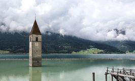 Church tower in the lake. Church tower in Reschenbachsee Royalty Free Stock Photography