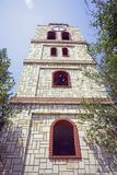 Church tower from below. Church tower with large windows and clock from below Royalty Free Stock Photos