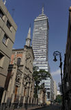 Church and Tower Mexico City. A church, two curved historical iron street lamps and a modern sky scrapper tower in downtown Mexico City Stock Image