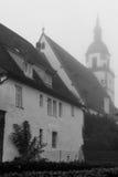 Church Tower at morning mist Stock Photos