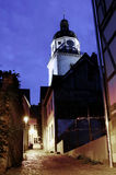 Church tower at night. Look from a narrow lane at a church tower at night Stock Photos