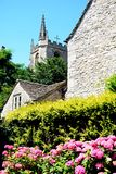 Church tower and pretty plants, Castle Combe. Stock Photo