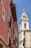Church tower and red house in the center of Xativa Royalty Free Stock Image