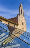 Church tower with reflection in glass roof in Astorga Stock Photo