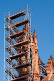 Church tower renovation against a blue sky royalty free stock image