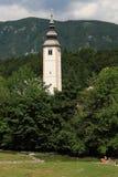 Church tower in Ribčev Laz. White church tower Ribčev Laz in Bohinj basin, Julian Alps, Slovenia Royalty Free Stock Images