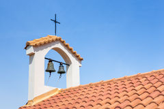 Church tower on roof with bells and cross Royalty Free Stock Images