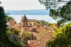 Church tower and roofs of buildings at old town Omis stock photography