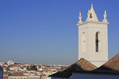 A church tower and the rooftops of the skyline of Tavira, Portugal Stock Photography
