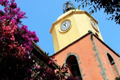 Church tower Saint-Tropez notre dame de l assomption in spring. Church tower Saint Tropez, parish church, Eglise Notre Dame de l`Assomption from the 16th century stock photo