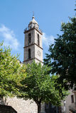 Church tower in Sartene, Corsica with modern clock Royalty Free Stock Photos