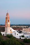 Tower of the Church of the Savior, Ayamonte. Sunset at the Tower of the Church of the Savior, in the white village of Ayamonte in Huelva, southern Andalucía Royalty Free Stock Photo
