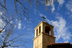Church Tower, Sedona, Arizona, USA. An older church tower with a wooden cross on top set against blue sky. The church is in Sedona, Arizona, USA Stock Photos
