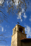 Church Tower, Sedona, USA. An older church tower set against blue sky. It is winter and the tree branches are bare Royalty Free Stock Photos