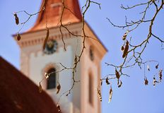 Church tower with shining branch on foreground, Purkarec, Czech republic Royalty Free Stock Image