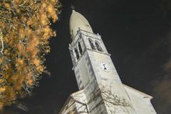 Church tower shot from bellow night shot. Church tower shot from bellow. architecture night scene in autumn season Stock Image