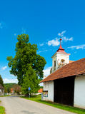 Church Tower. In Skryje, Czech Republic, stretching over a barn Royalty Free Stock Photo