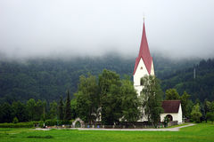 Church with tower. Small church with high tower near forest in mountain, Austria Royalty Free Stock Images