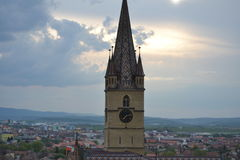 Church tower. The Church tower and spectacular clouds in Romania Royalty Free Stock Images
