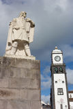 Church Tower and statue of monk and Commander Cabral in Ponta Delgada, Azores, Portugal. Royalty Free Stock Image