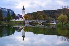 Church tower and stone bridge at Lake Bohinj Royalty Free Stock Image