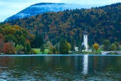 Church tower and stone bridge at Lake Bohinj Royalty Free Stock Photo